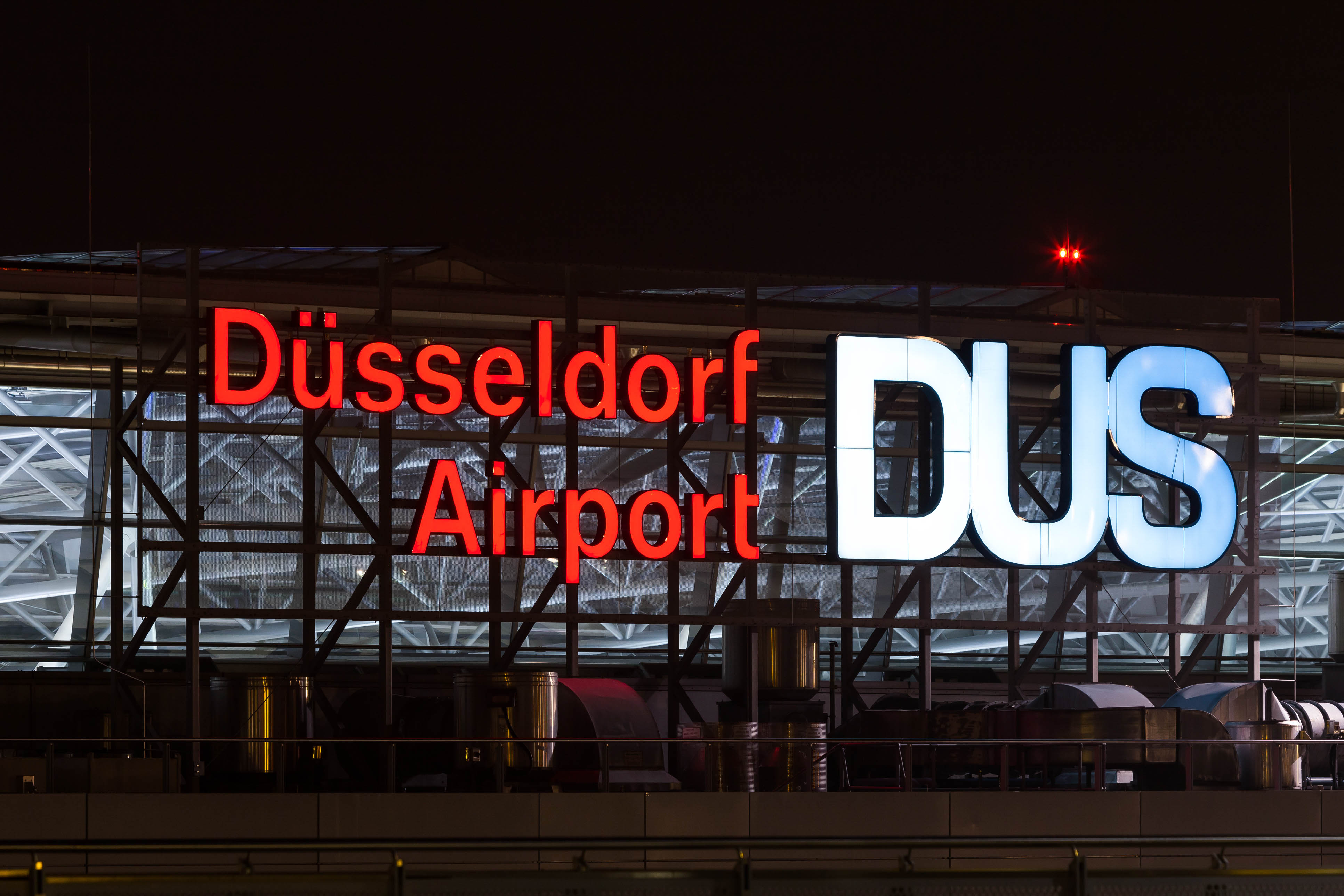 duesseldorf airport germany sign at night